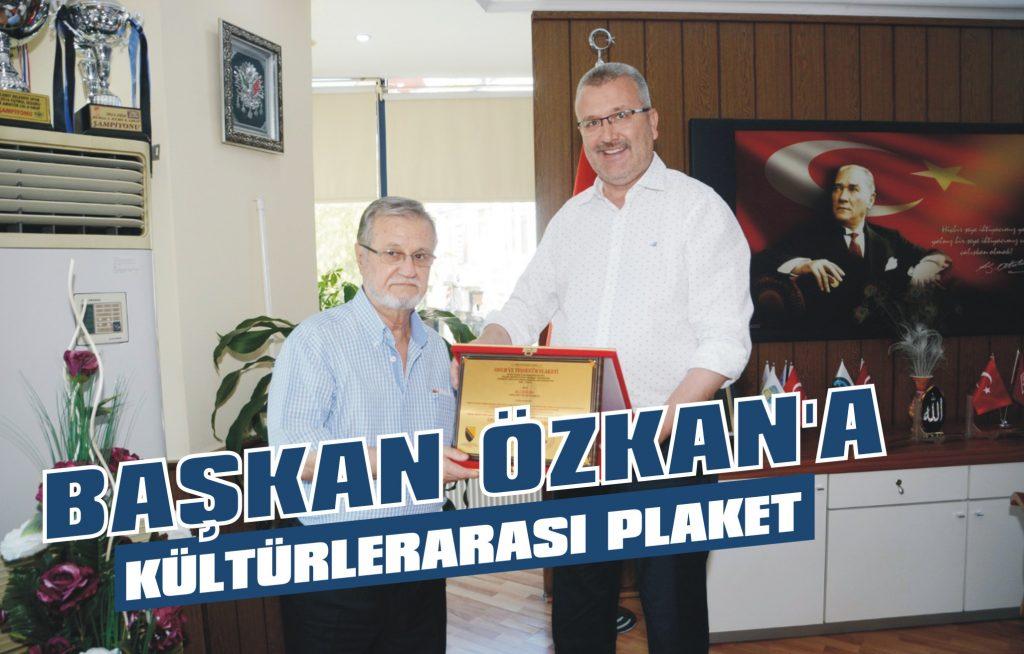 Başkan Özkan'a kültürlerarası plaket